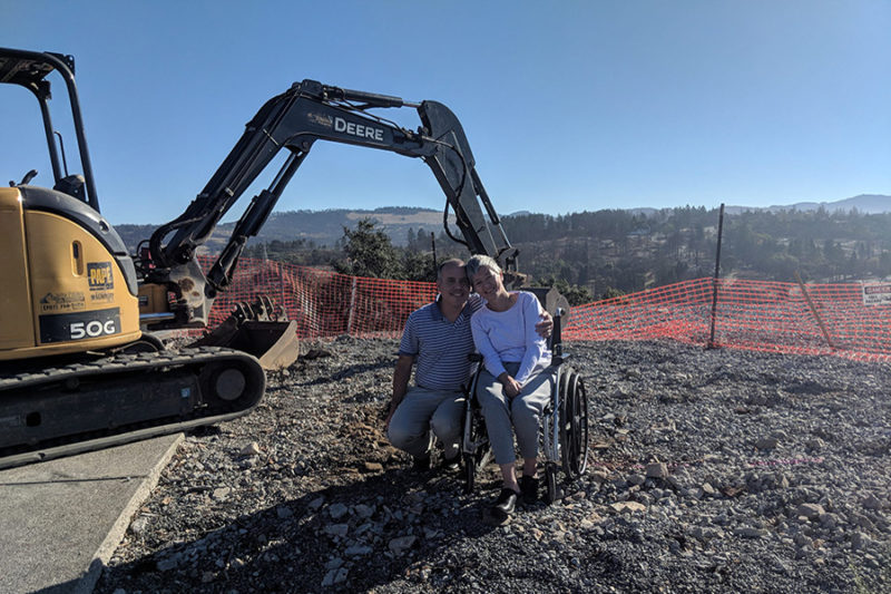 LEFF construction fountaingrove the Berry family pose in front of a tractor for ground breaking