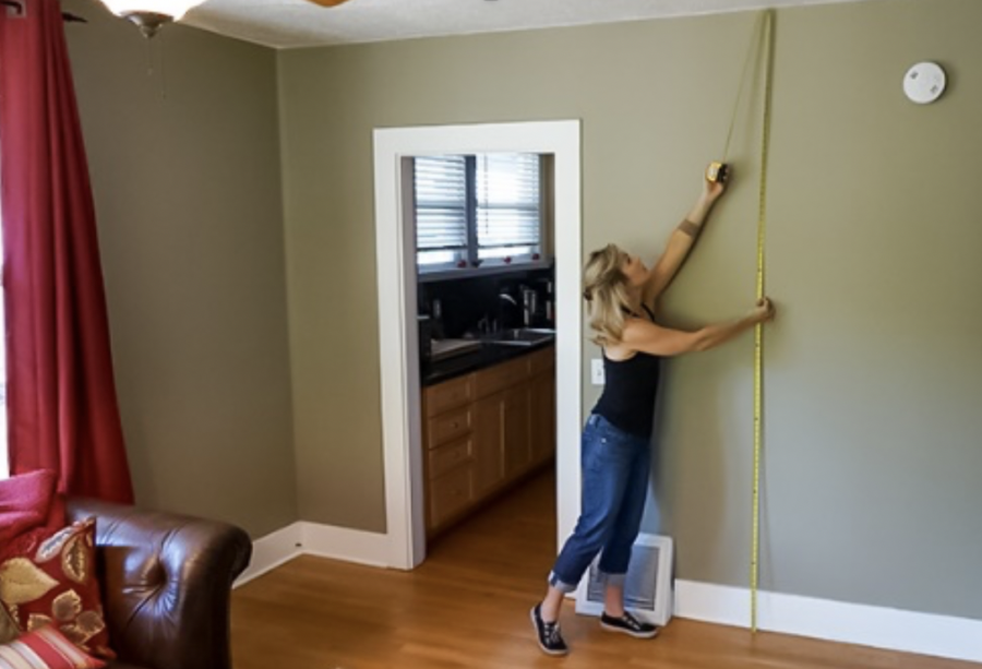 Designer measuring a wall